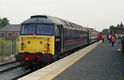 After the resident DMU had been damaged in a collision with an obstruction on the line a couple of days earlier, the Wensleydale Railway turned out 47715 on a two-coach rake as a replacement. 'Poseidon' waits to depart from Leeming Bar with the 1005 to Redmire