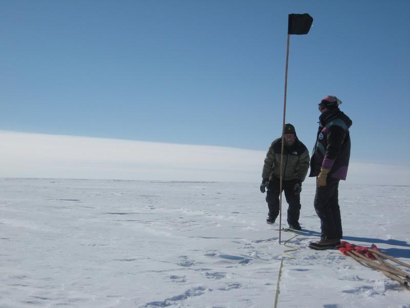 """Marking the skiway.<br /> <br /> Markering af landingsbanen, """"skiwayen""""."""