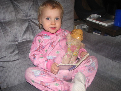 Kathryn reads a  book to her doll (which was my doll when I was little).
