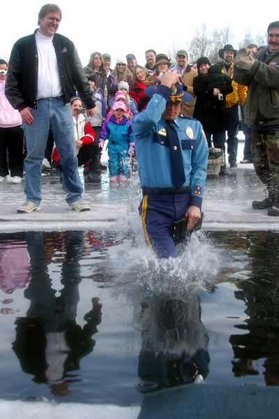 A representative from the Alaska State Troopers took the plunge, ticket book in hand.