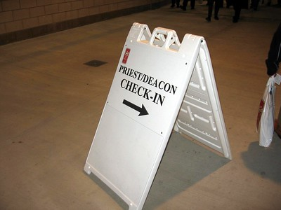 Sign in the concourse for priests and deacons to check in