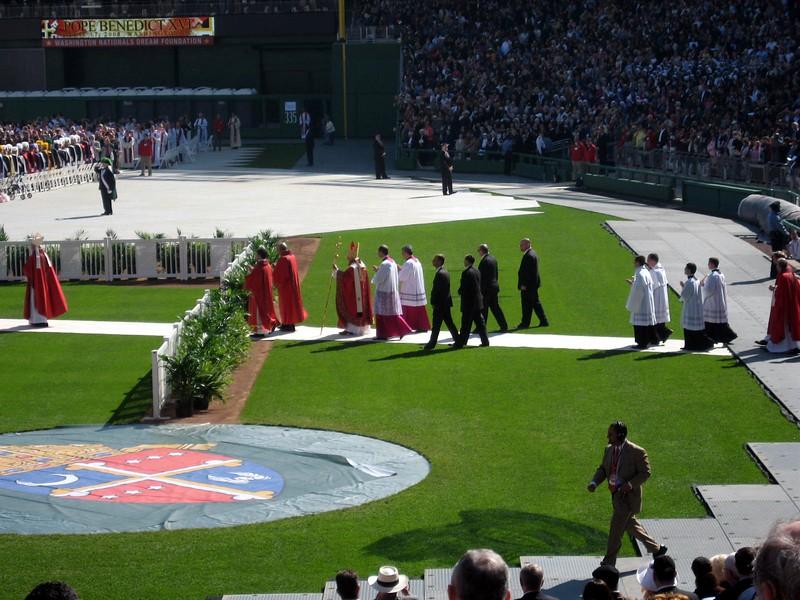 Pope Benedict XVI enters the stadium again to begin the Mass