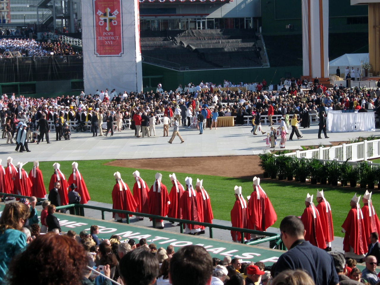 The bishops process onto the field before the Mass