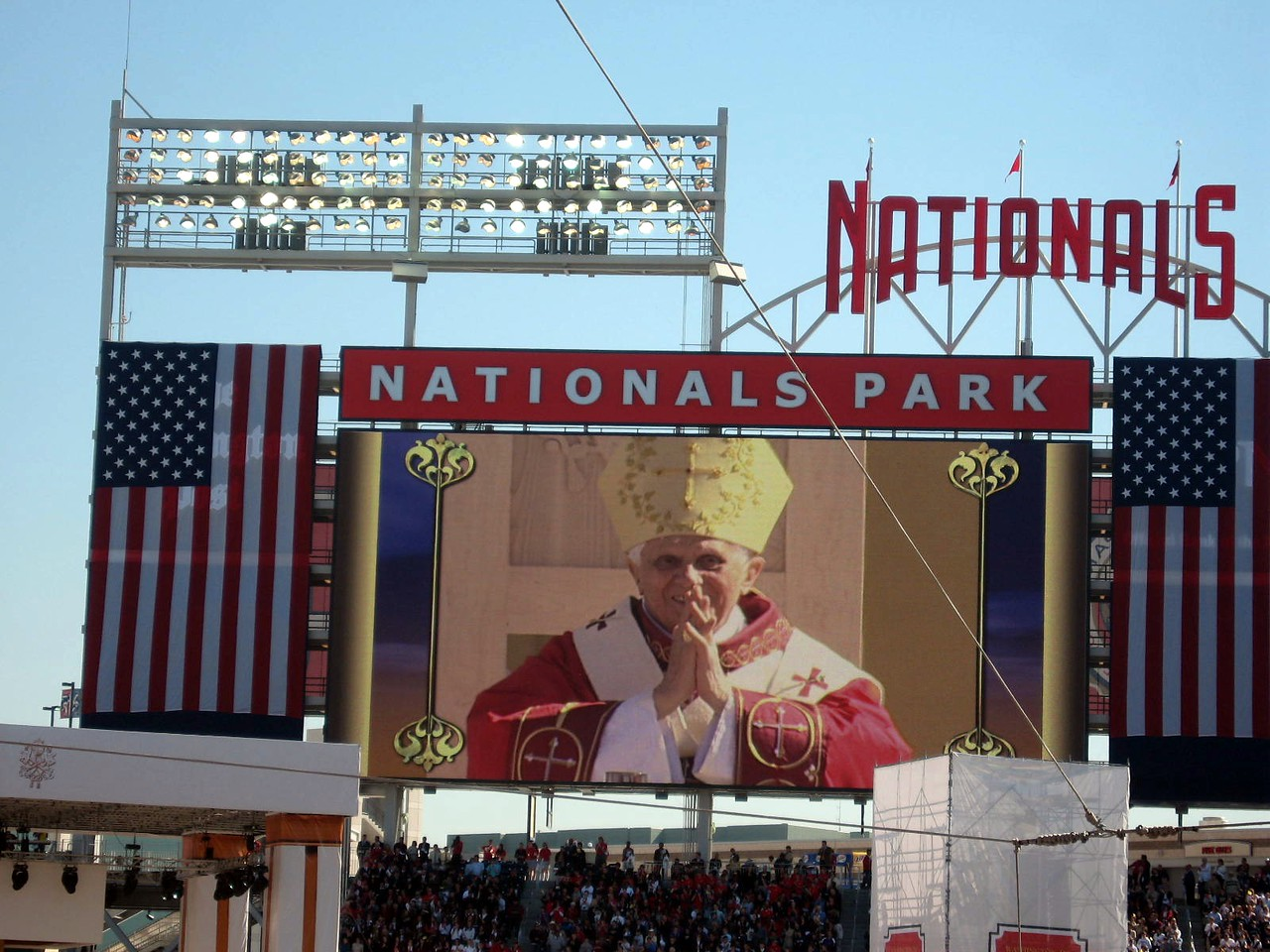 Pope Benedict XVI responds to the crowd's welcome