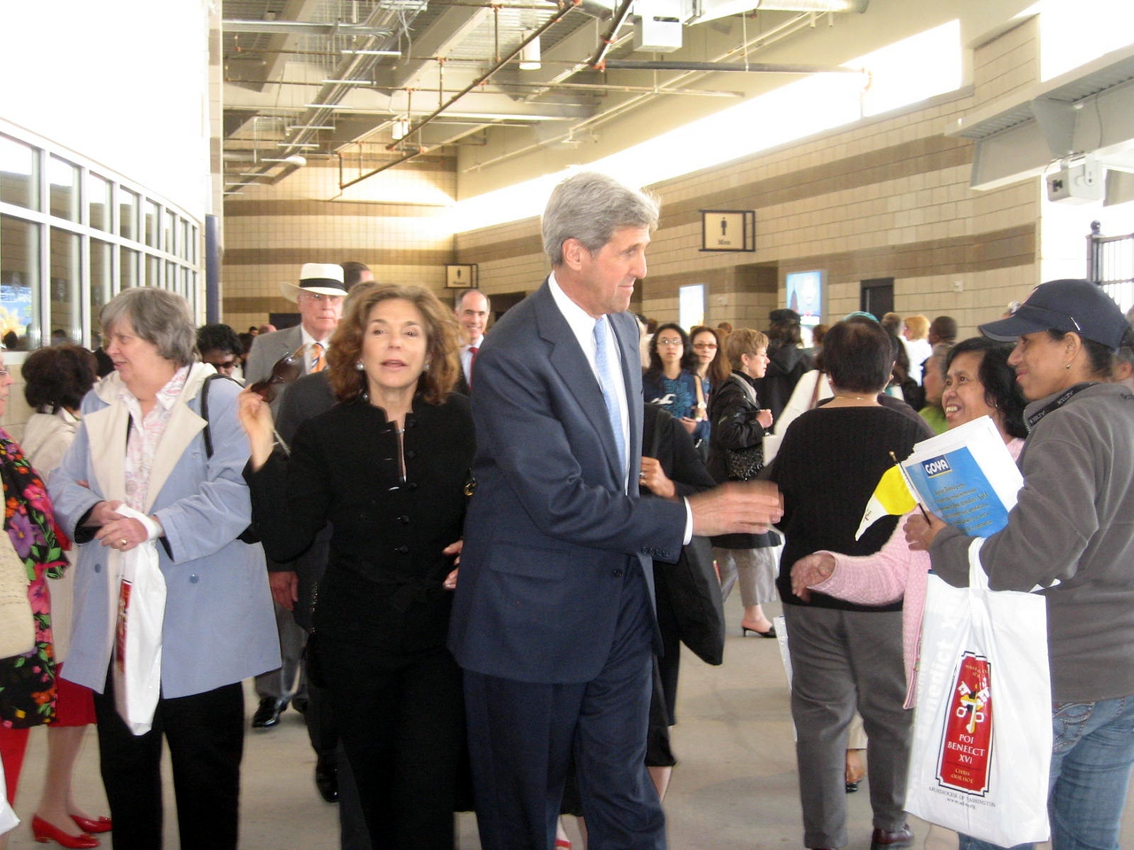 Teresa Heinz and U.S. Senator John Kerry leave after the Mass.  Behind them in the white hat is U.S. Senator Patrick Leahy.