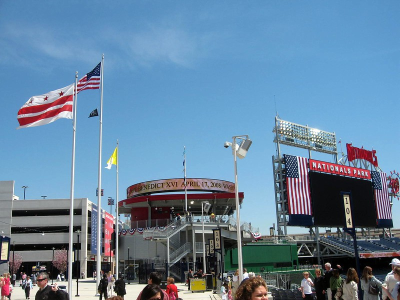The flag of the District of Columbia (l), flag of the United States,  POW/MIA Flag, and flag of the Vatican City, inside the Centerfield Gate at Nationals Park