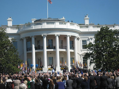 First Lady Laura Bush, Pope Benedict XVI, and President George W. Bush greet the crowd from the South Portico Balcony of the White House