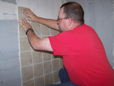 Dad tiling the shower