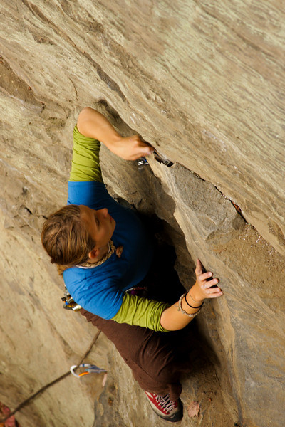 Tracy slots a nut behind a rather thin flake on her way up a 5.8+.