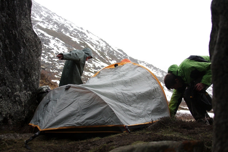 A light rain begins to fall as camp is established.