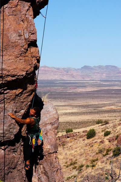 Kelsey works toward the crux roof of a 5.10c.