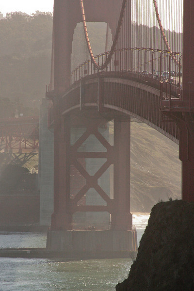 Haze drifts around the pylons of the Golden Gate Bridge.