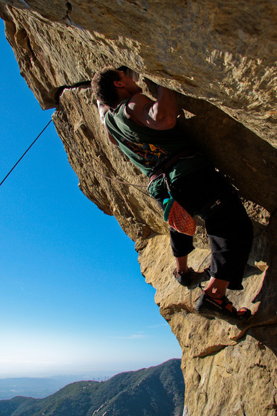 Kelsey moves into the hard hand jams of <i>The Nose 5.11b</i> on Gibraltar Rock.