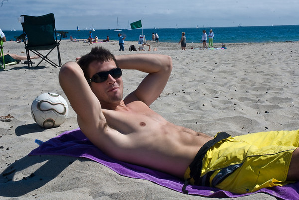 Danny relaxing in his sand chair at the beach