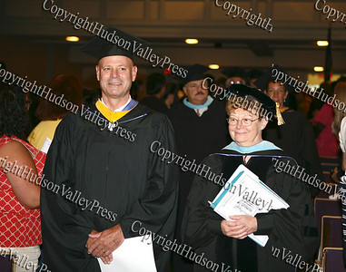 Newburgh Free Academy Principal Peter Copeletti and Superintendent of Schools Dr. Annette M. Saturnelli lead the academic processional of graduates during the summer graduation exercises on August 21, 2008 at Newburgh Free Academy.