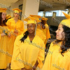 NFA graduates Tasha Lenee' Belizaire and Johanna Aleman look at their male counterparts as they line up for the Newburgh Free Academy summer graduation on August 21, 2008.