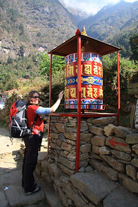 Susan spins a prayer wheel