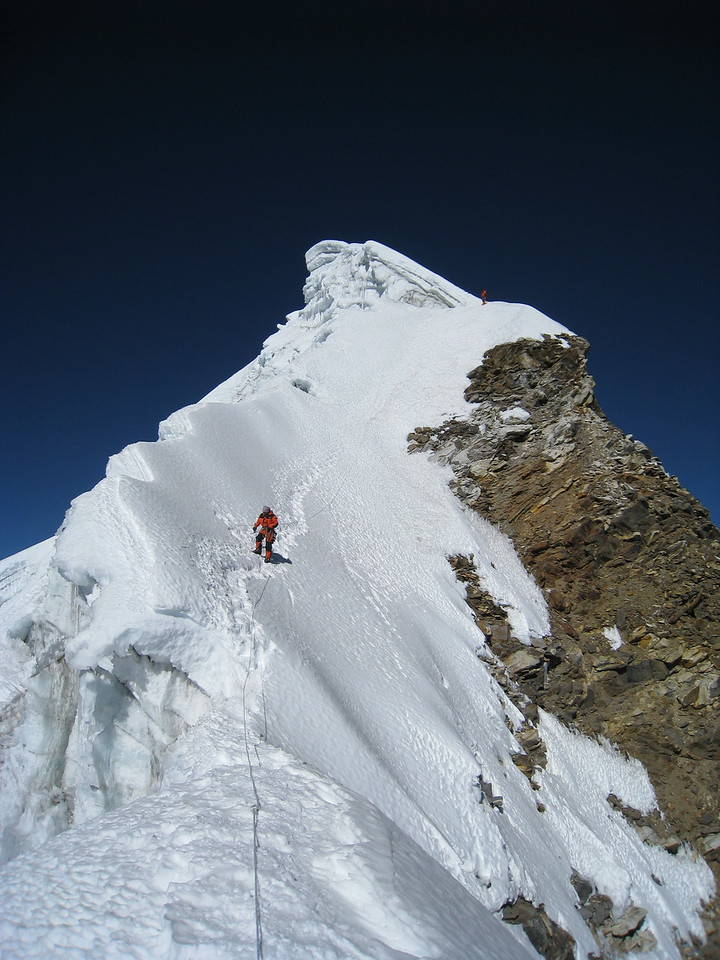 Mingma cleans the route after team ascent.