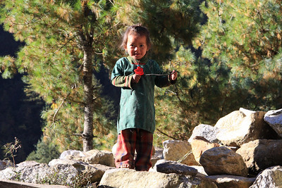 Small girl playing on trail near Phakding