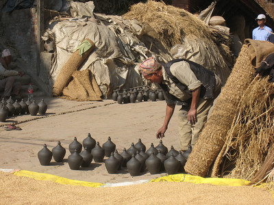 Bhaktapur - UNESCO World Heritage Site (Kathmandu, Nepal) Pottery artisan drying pots in air.