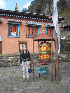 Nicola at a prayer wheel
