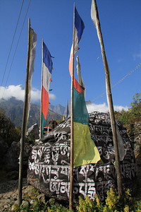 Prayer flags and Mani Stone