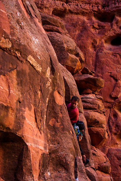 Kelsey looks for hold around him on the first pitch of <i>The Windows Route 5.10b</i>.