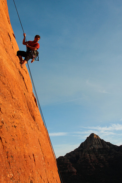 Kelsey lowers down the Sedona mountainside on the rappel from <i>Mars Attacks 5.8</i>.