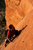 Kelsey works through some slabby moves high over the Arizona desert on <i>Mars Attacks 5.8</i>.