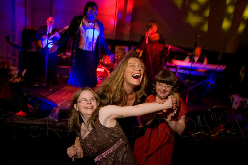"(Broomfield, Colorado, Sept. 27, 2008)<br /> Dancing to Hazel Miller and Sheryl Renee are Hanna Atkinson with Krista Agramonte and Donene Mumaw (sister of Agramonte).  ""Be Beautiful Be Yourself Jet Set Fashion Show,"" benefiting The Rocky Mountain Down Syndrome Educational Fund and Arc Thrift of Colorado, at Rotors of the Rockies in Broomfield, Colorado, on Saturday, Sept. 27, 2008.<br /> STEVE PETERSON"