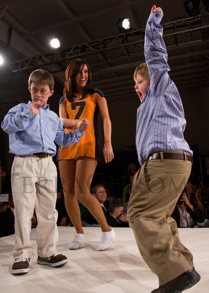 "(Broomfield, Colorado, Sept. 27, 2008)<br /> Logan Borer (left) and Dylan Secrist with a Colorado Crush Cheerleader.  ""Be Beautiful Be Yourself Jet Set Fashion Show,"" benefiting The Rocky Mountain Down Syndrome Educational Fund and Arc Thrift of Colorado, at Rotors of the Rockies in Broomfield, Colorado, on Saturday, Sept. 27, 2008.<br /> STEVE PETERSON"