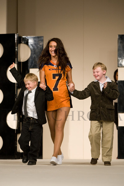 "(Broomfield, Colorado, Sept. 27, 2008)<br /> Colorado Crush Cheerleader with Jack Holm (left) and Will Harmon.  ""Be Beautiful Be Yourself Jet Set Fashion Show,"" benefiting The Rocky Mountain Down Syndrome Educational Fund and Arc Thrift of Colorado, at Rotors of the Rockies in Broomfield, Colorado, on Saturday, Sept. 27, 2008.<br /> STEVE PETERSON"
