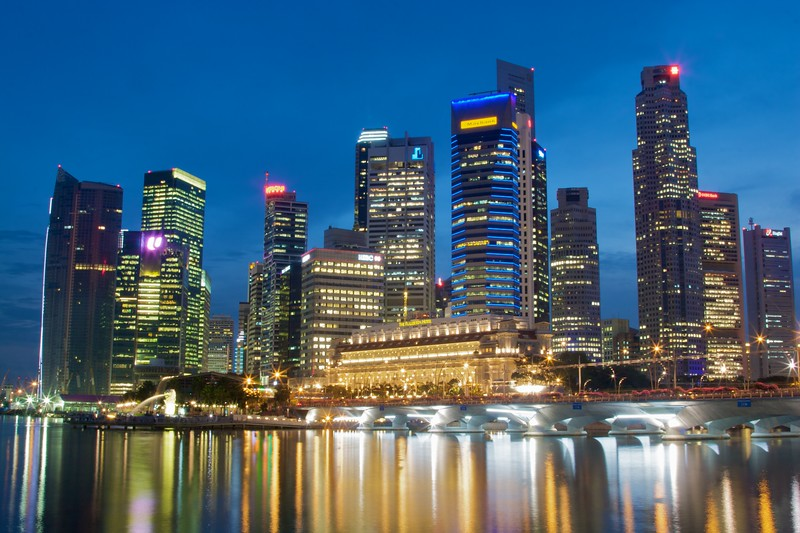 The towers downtown Singapore next to the harbour/bay. There is a stricct height restriction on buildings in Singapore so as not to interfere with flight operations at the island's two airports, principally the major international airport, Changi.