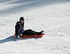 Isabel sledding.