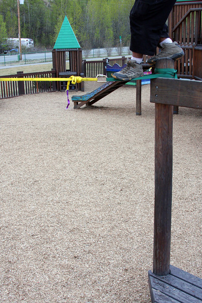 Kelsey's feet tentatively try a midline rigged at the playground in Wasilla.