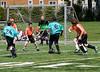 Yikaalo shooting at the goal; Benjamin looking on