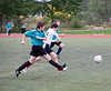 William and Sam go for the ball