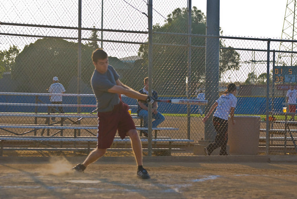 Carl hits the ball in his first at bat.