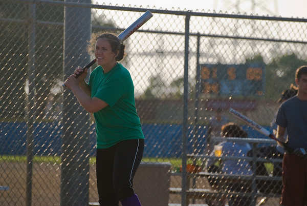 Sasha taking some practice swings in between pitches.