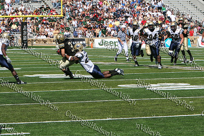 Running Back Carlo Santiago is stopped by Akron during their game on Saturday, September 20, 2008 at Mitchie Stadium.