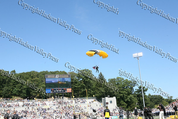 A member of the Black Knights Parachute Team lands on the 50-yard-line at Mitchie Stadium prior to Army's game versus Akron on Saturday, September 20, 2008.