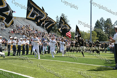 Army cheerleaders lead the way as West Point takes the field against Akron on Saturday, September 20, 2008 at Mitchie Stadium.