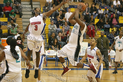 Hudson Valley Hawks' Ameshem Foluke Henderson scores two points over Alexandria Avengers' Brian Carter during their NPBL match up in Beacon on April 2, 2008.