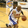 An Avengers player gets past the Hudson Valley Hawks defense during their NPBL match up.