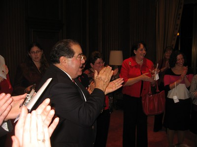 Associate Justice Antonin Scalia leads the crowd in thanking the pianist