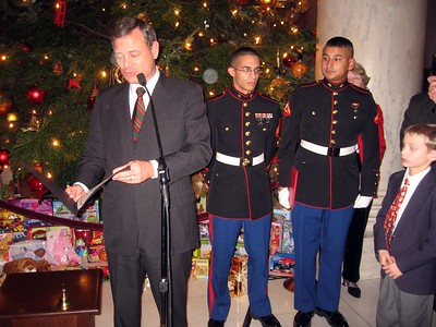Chief Justice John Roberts presents a certificate regarding the Court's participation in the Toys for Tots program