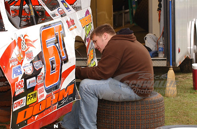 Zack Dohm works on his dad's car