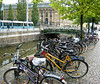 Bicycles parked along a canal