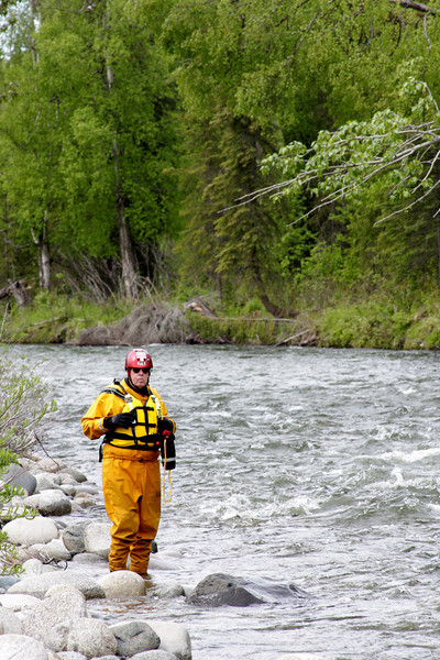 Long-time water rescuer Walt Gilmore stands ready downstream should things go wrong.