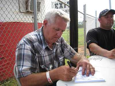 Freddy Smith signs an autograph